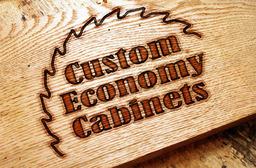 Large custom economy cabinets logo on board