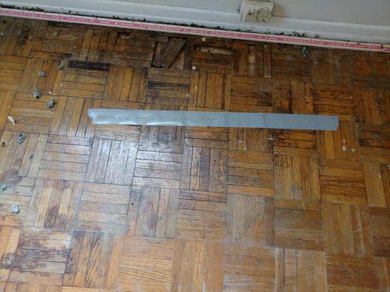 Parquet Hardwood Floor Water Damage