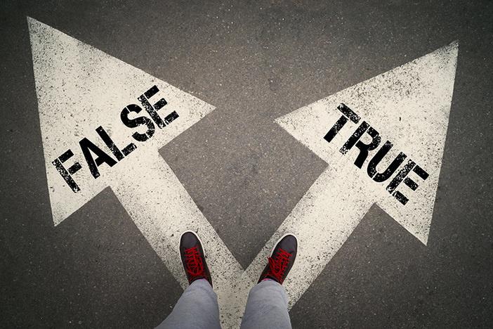 TRUE versus FALSE written on the white arrows, dilemmas concept.