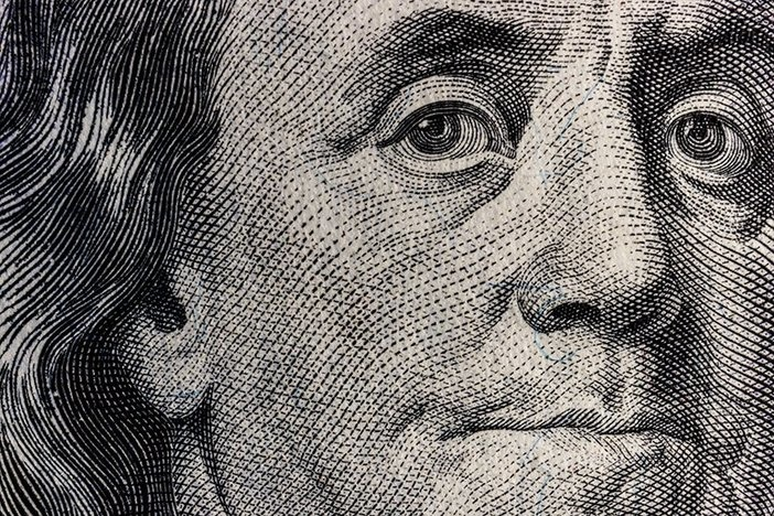 Closeup of Ben Franklin on a one hundred dollar bill