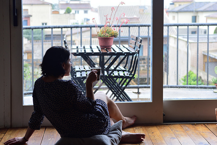sad woman sitting and looking out the window