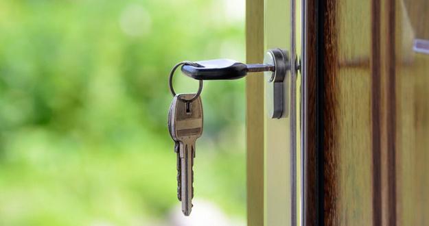 closeup of key in lock on door