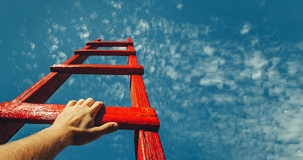 Mans Hand Reaching For Red Ladder Leading To A Blue Sky