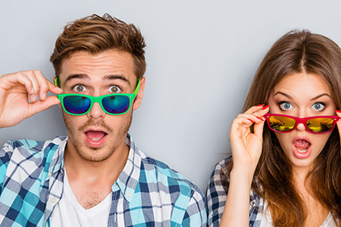 Surprised man and woman in glasses with open mouth