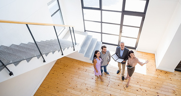 real estate agent giving a home tour to clients