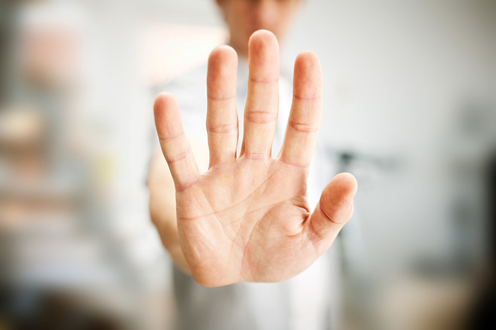 closeup of man showing stop gesture with his hand