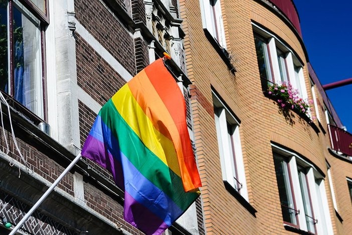 Amsterdam, The Netherlands, 3rd August 2013 - A Rainbow Flag flies from a house during Amsterdam Gay Pride