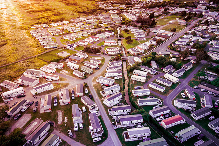 Sun set at a Caravan and camping park, static home aerial view.