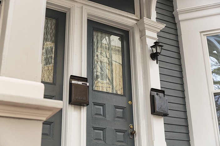 Front door, gray with white trim with pillars