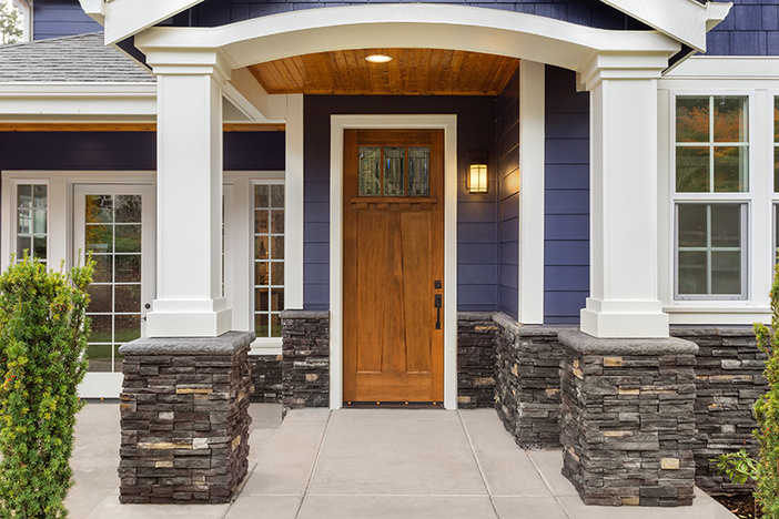 New Luxury Home Exterior Detail: New House Front Door and Covere